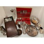 Lot 12 - Contents to tray - a part canteen of plated table cutlery, other cutlery, claret jug, plated trays,