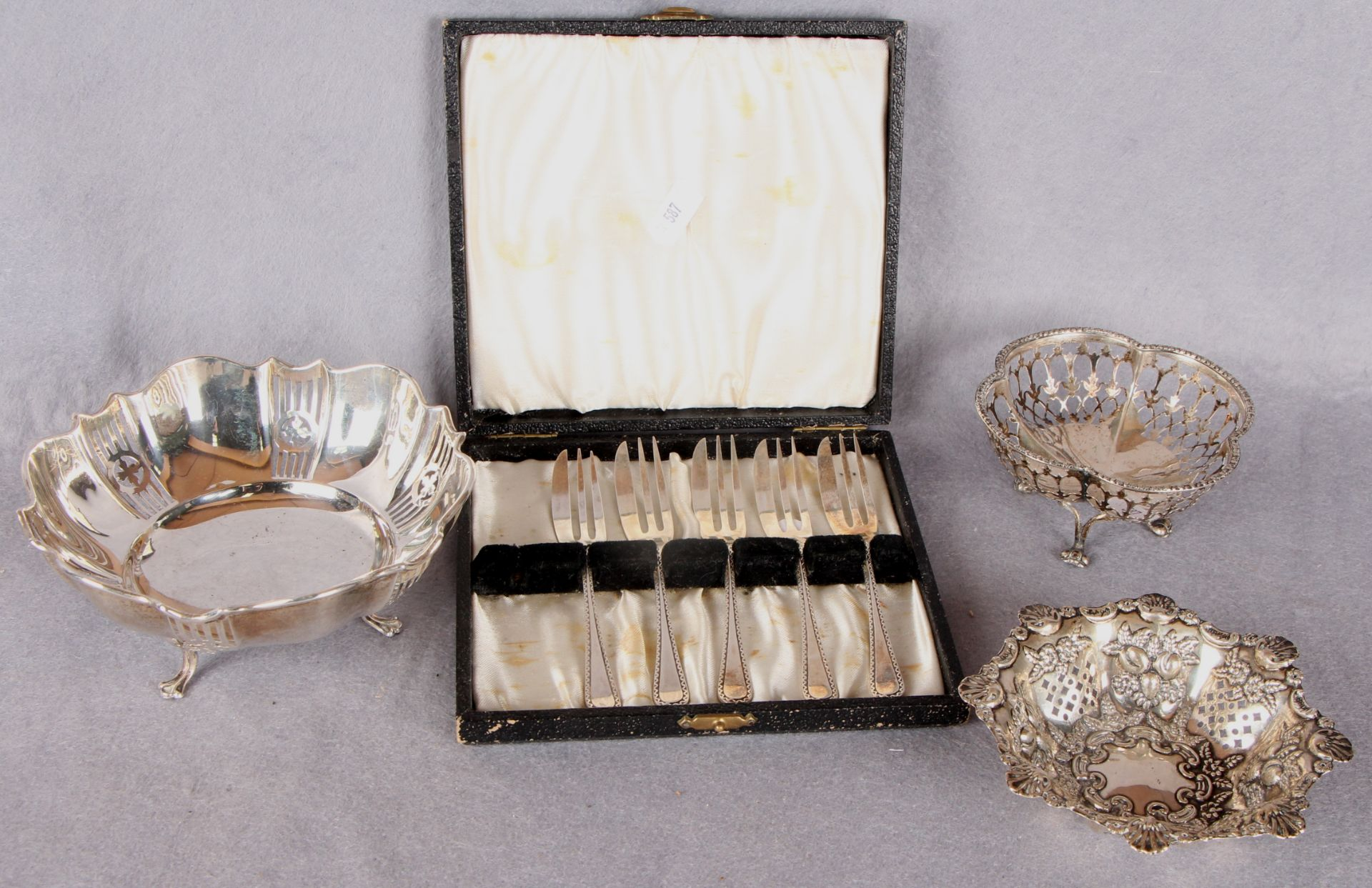 Lot 46 - A shaped circular bonbon dish pierced to the angles and on three shaped supports,