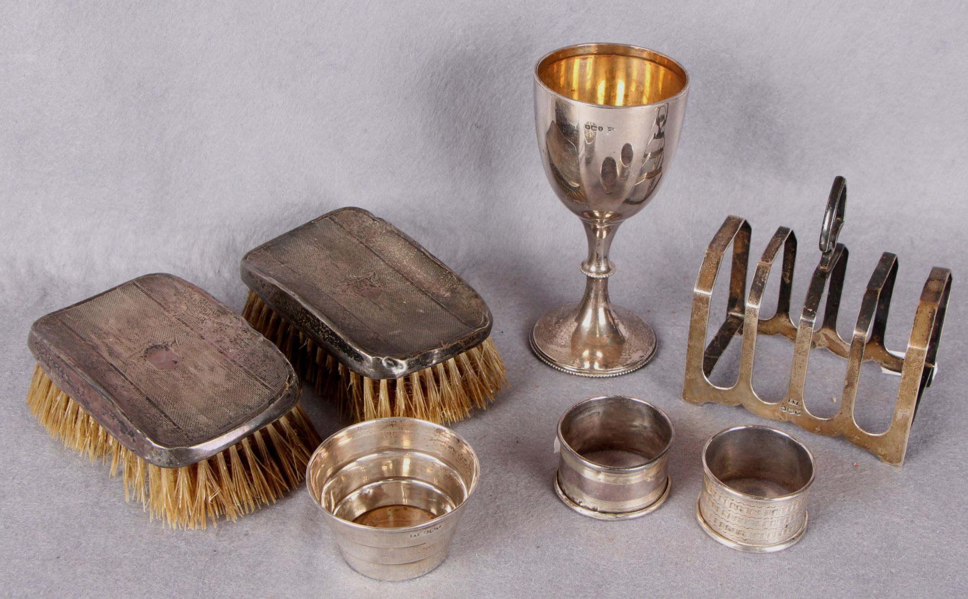 Lot 45 - Silverwares comprising semi-ovoid wine goblet, Sheffield 1896, four division toast rack,