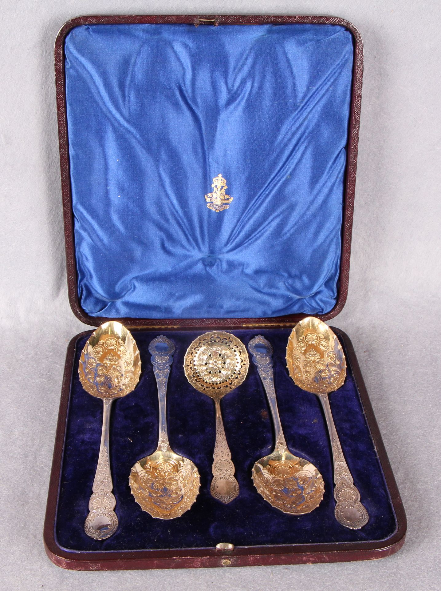 Lot 32 - A Victorian silver fruit set comprising four bright cut and repoussé decorated fruit spoons with