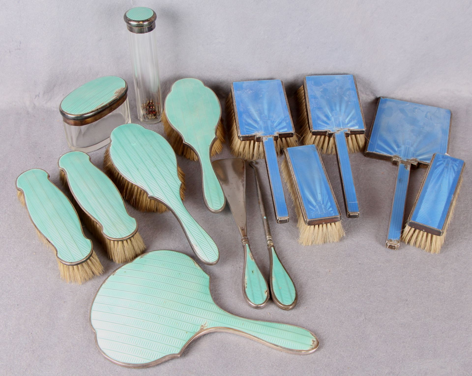Lot 54 - A silver and guilloche enamel five piece dressing table set (at fault) and another nine piece