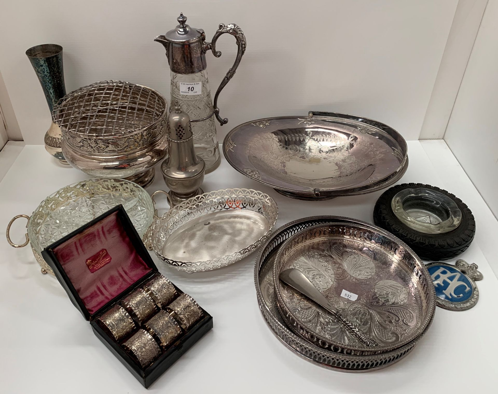Lot 10 - Plated claret jug, a set of six plated napkin rings, plated rose bowl, trays, etc.
