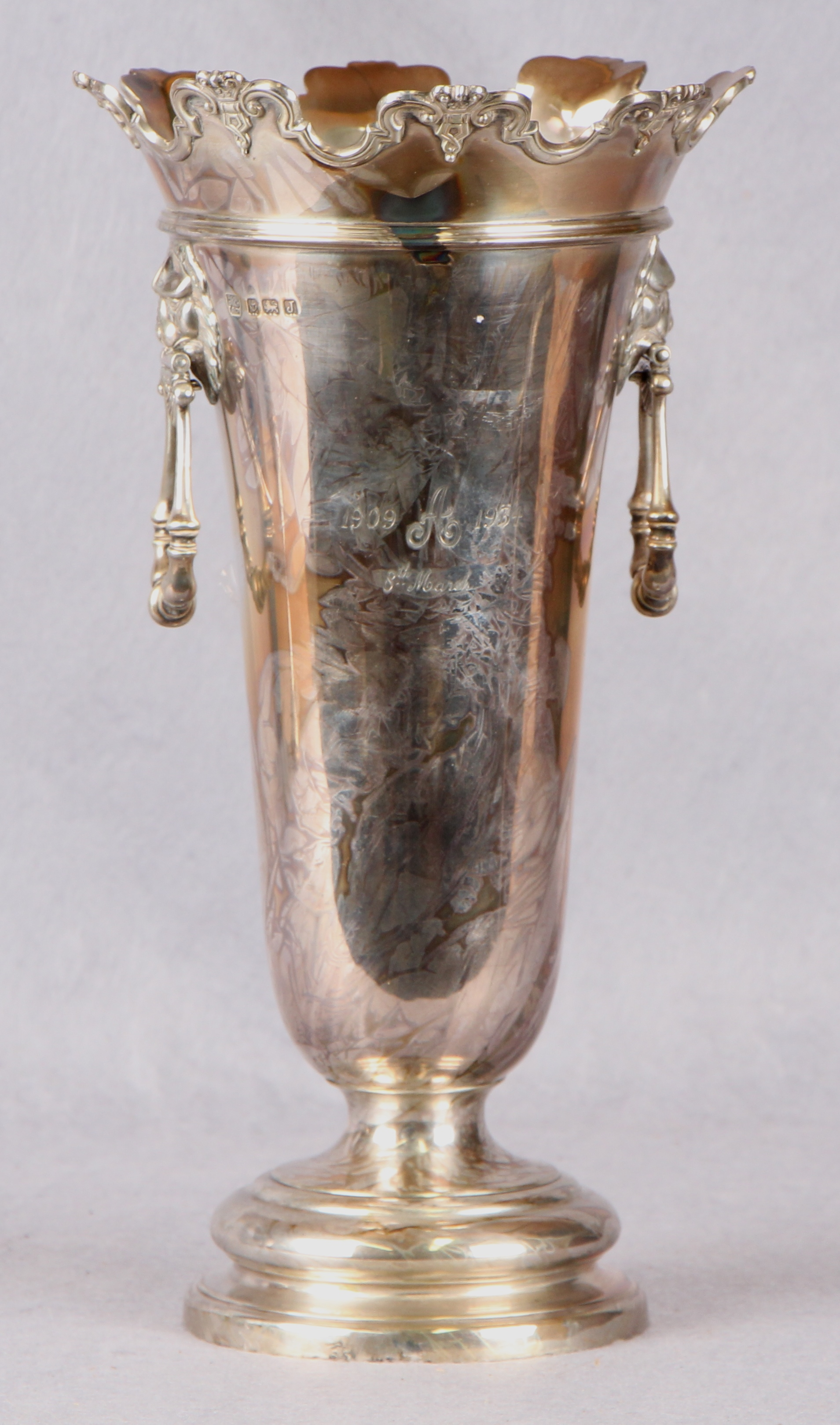 Lot 48 - A tapering circular section flower vase, twin folding mask and ring handles,