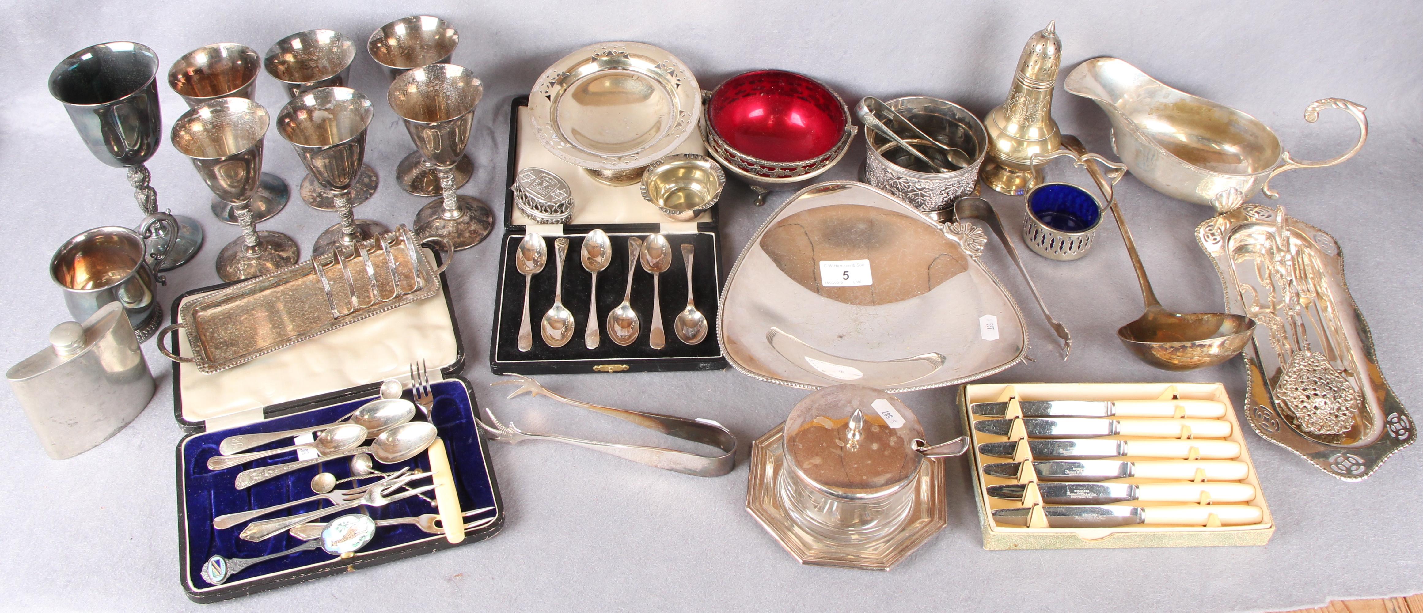 Lot 5 - A box of plated wares including wine goblets, assorted cutlery, some cased; sauce boat,
