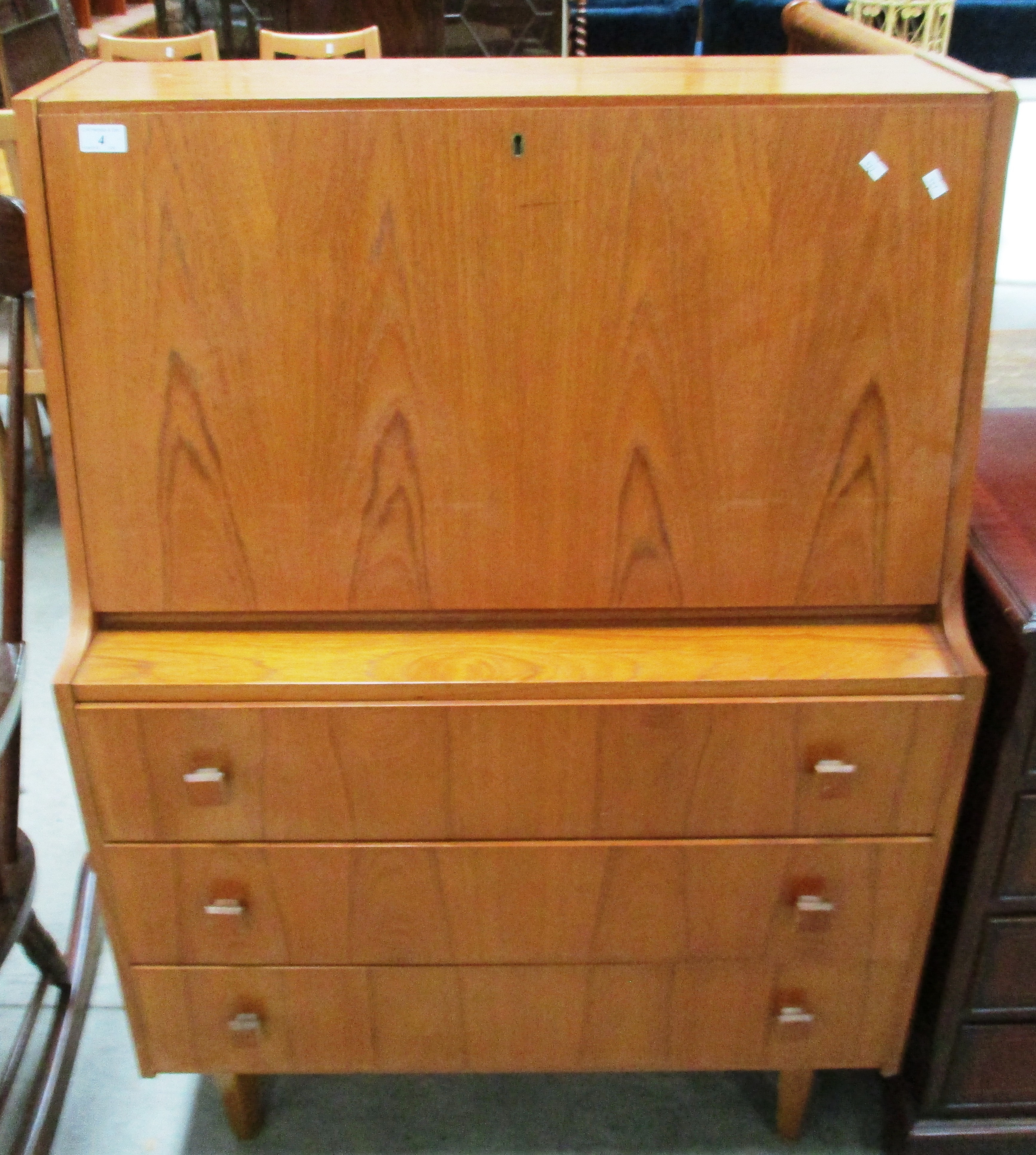 Lot 4 - A teak bureau with fall flap over 3 drawers 84cm