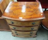 Lot 10 - A walnut bow front chest of 4 drawers 64cm
