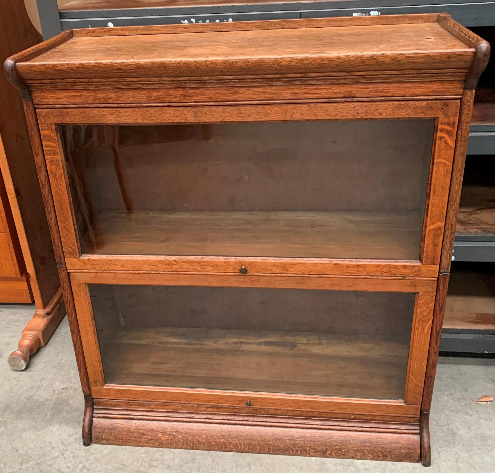 Lot 28 - An oak two height bookcase (Globe Wernicke style) with two glazed lift up doors 87 x 99cm high