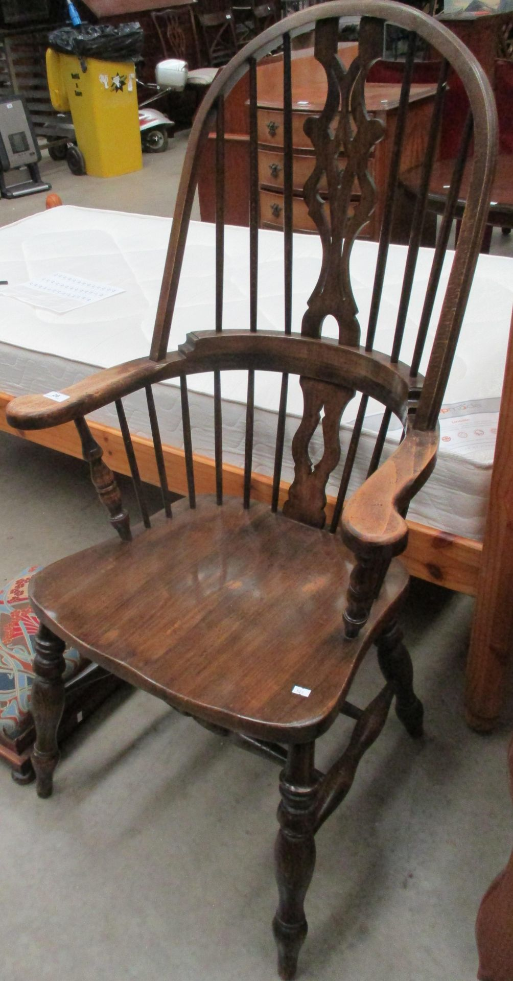 Lot 26 - An oak Windsor style armchair and an upholstered footstool (2)