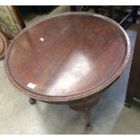 Lot 37 - A circular mahogany acanthus leaf carved edge coffee table on cabriole legs