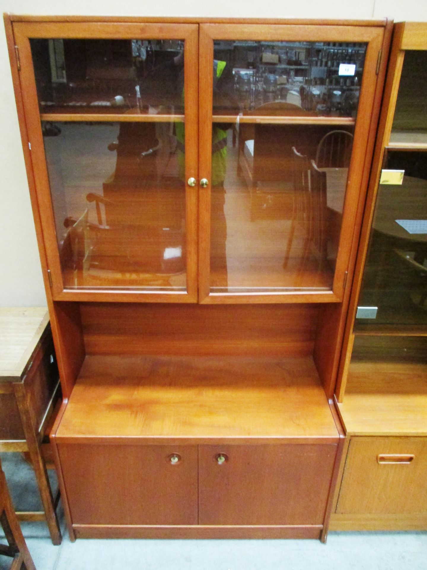 Lot 18 - A teak wall unit with 2 glazed doors over 2 door base 92 x 168cm high