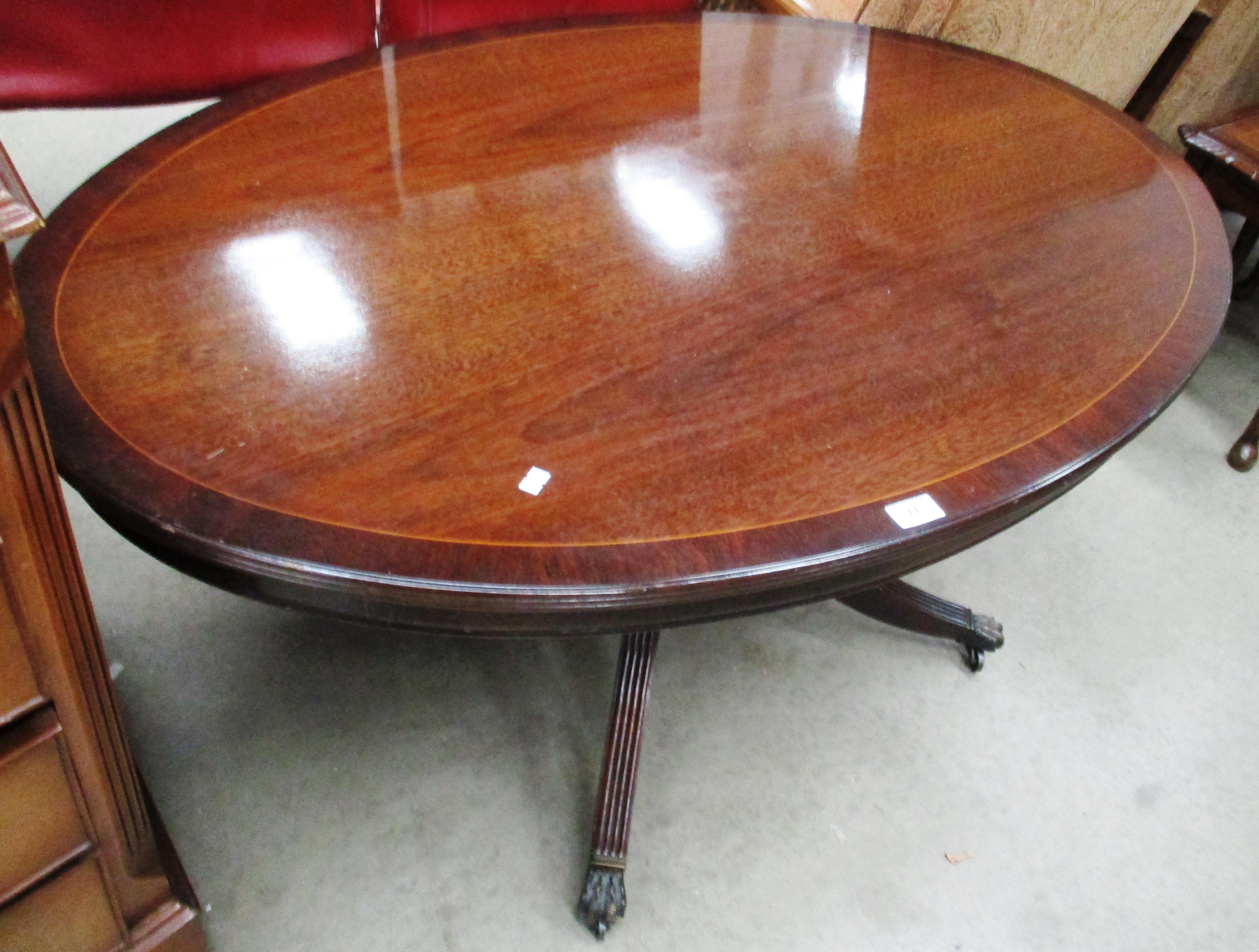 Lot 11 - A mahogany oval coffee table 120 x 77cm
