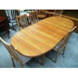 Lot 21 - A Caxton oak veneered dining suite comprising 'D' ended extending dining table 92 x 195cm extended