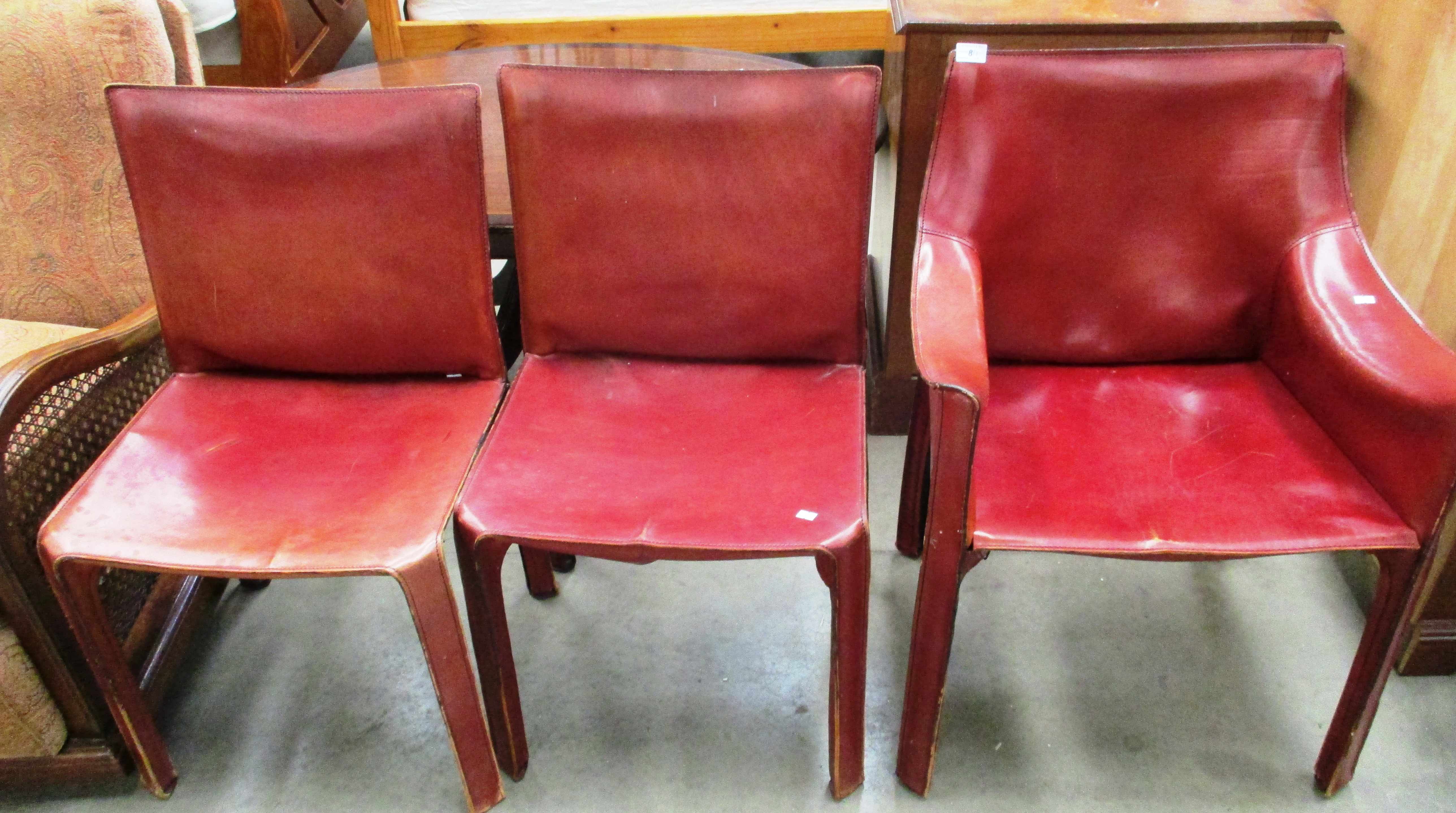 Lot 8 - A brown leather armchair and 2 matching side chairs (3)