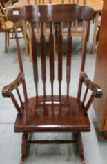 Lot 3 - Dark oak finish rocking armchair