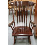 Lot 3 - Dark oak finish rocking armchair