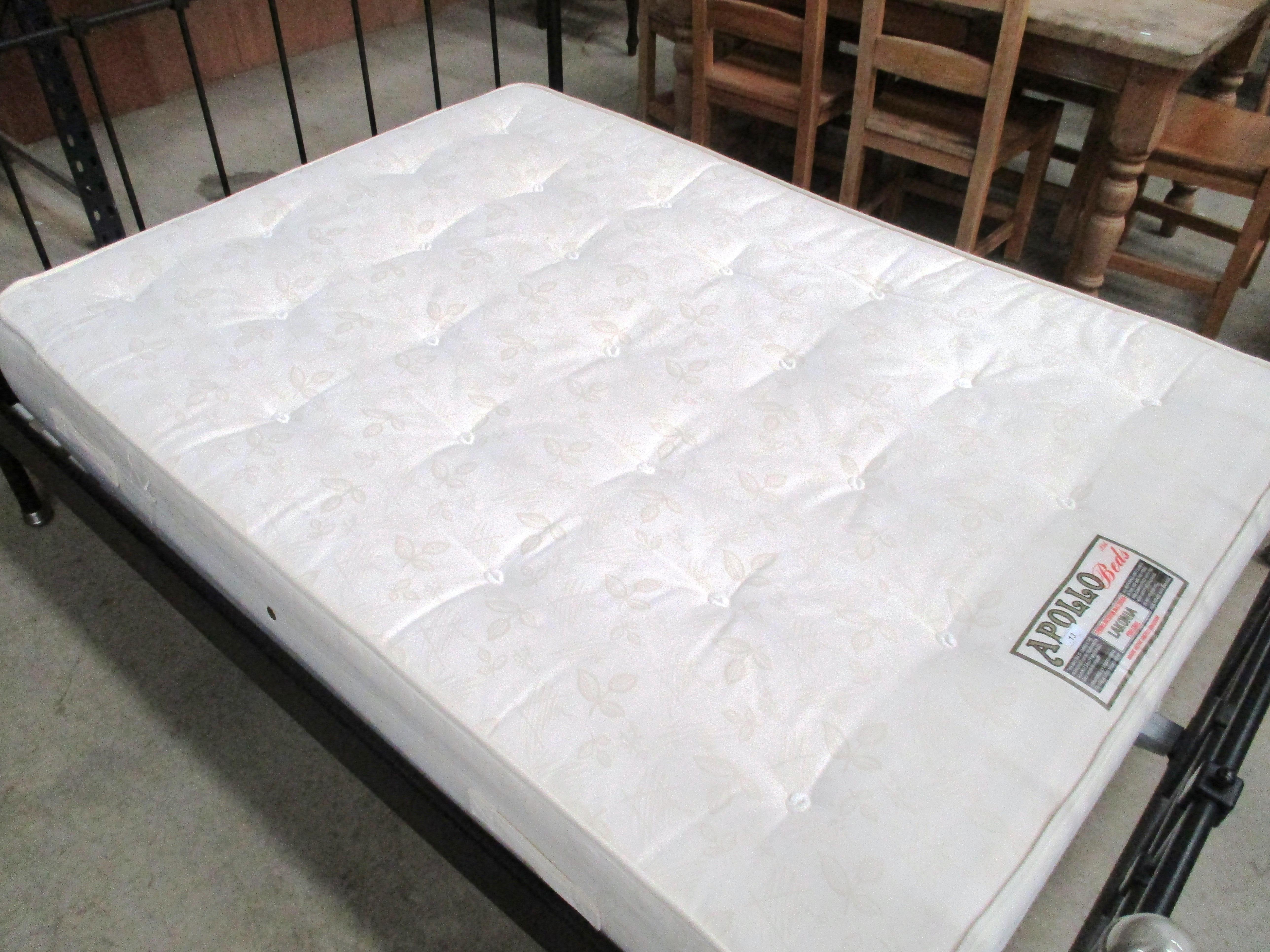 """Lot 13 - An Apollo Beds Lakonia 4'6"""" Pine Care sprung interior mattress"""