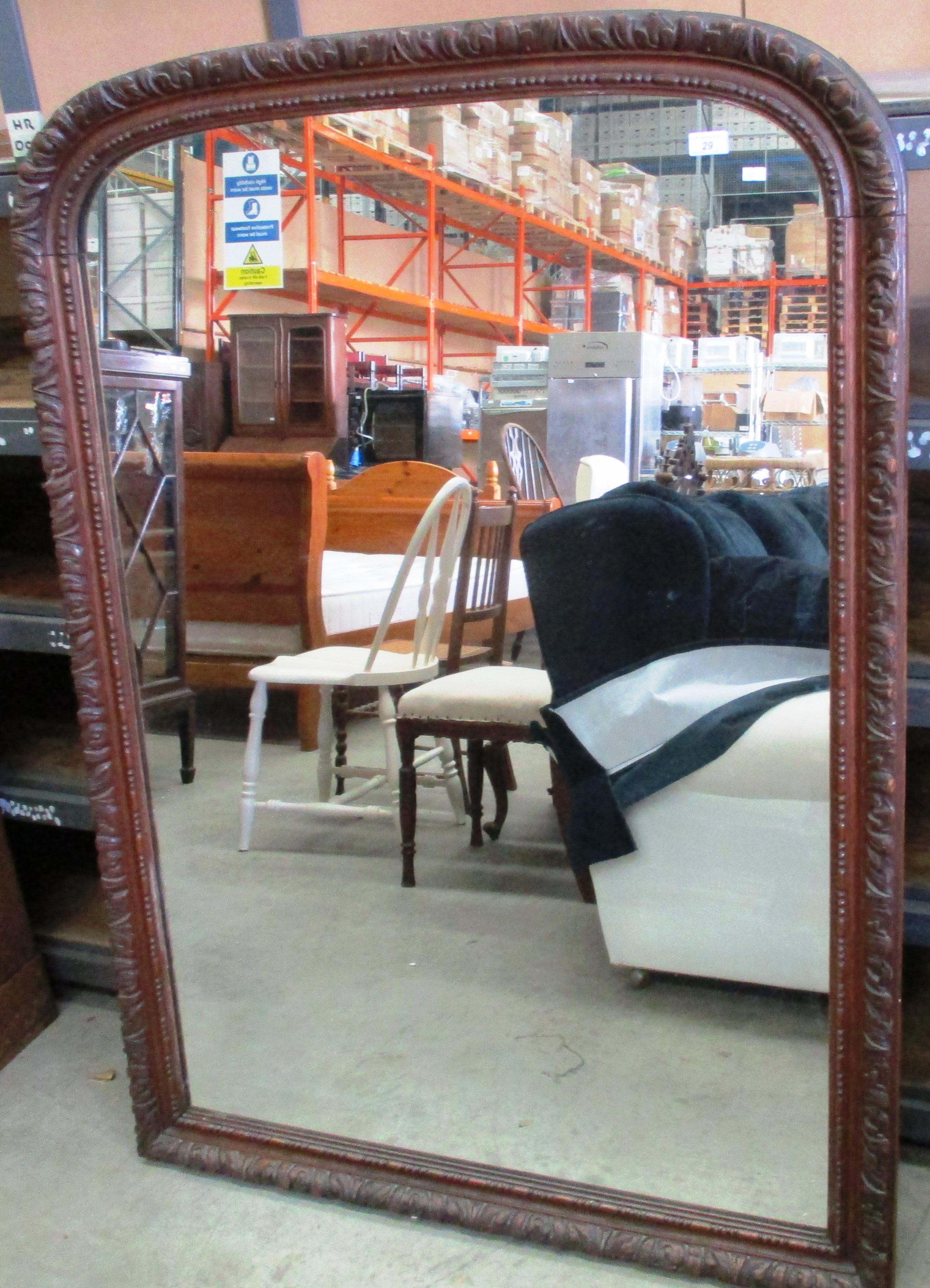 Lot 29 - A large carved oak framed mirror 146 x 105cm