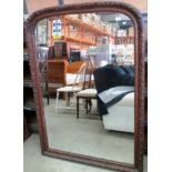 Lot 29 - A large carved oak framed mirror 146 x 105cm