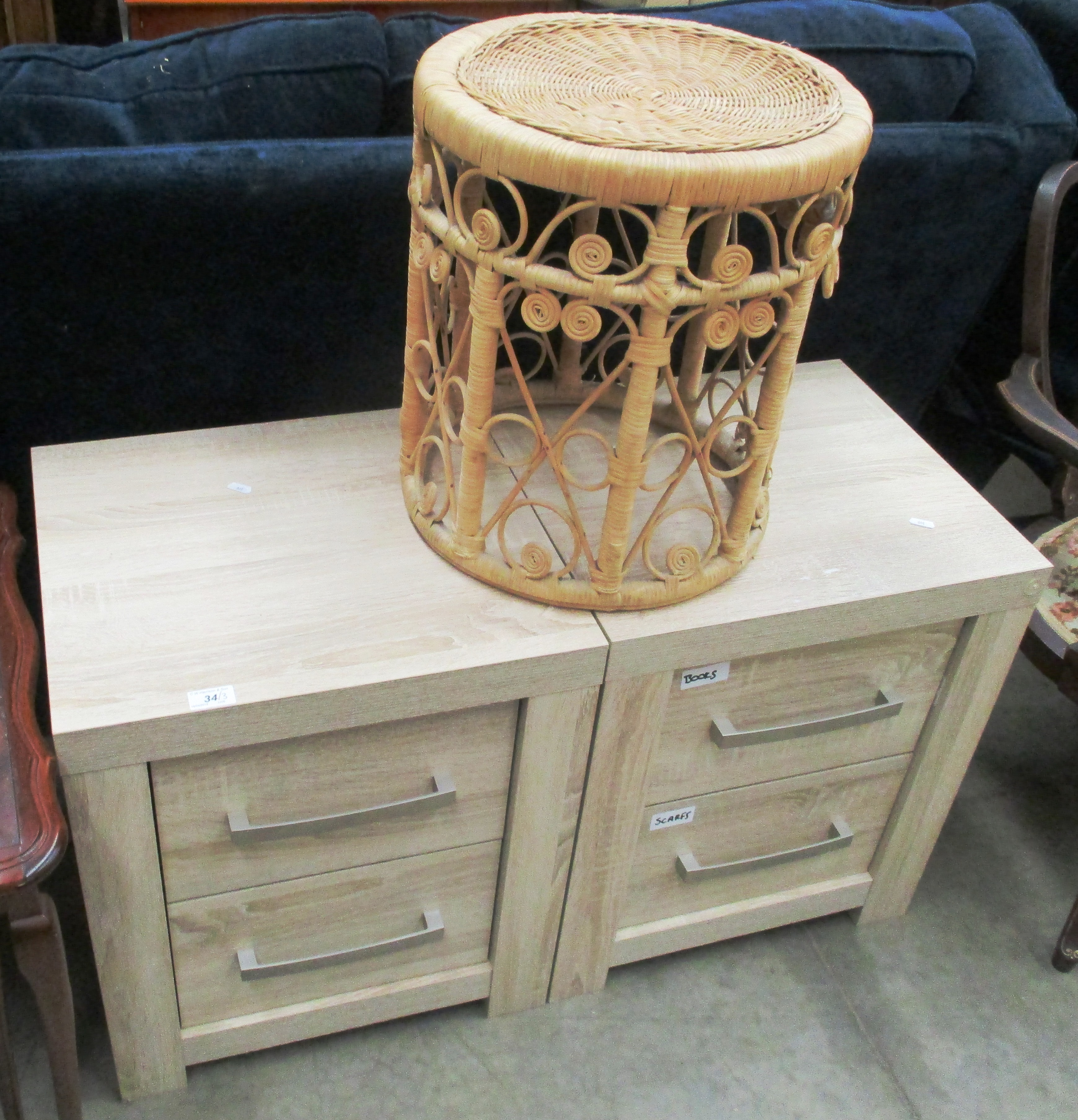 Lot 34 - A pair of limed oak 2 drawer bedside cupboards and a woven circular stool (3)