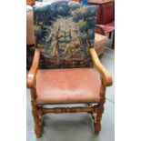 Lot 6 - An oak framed armchair with tapestry back and light brown hide seat