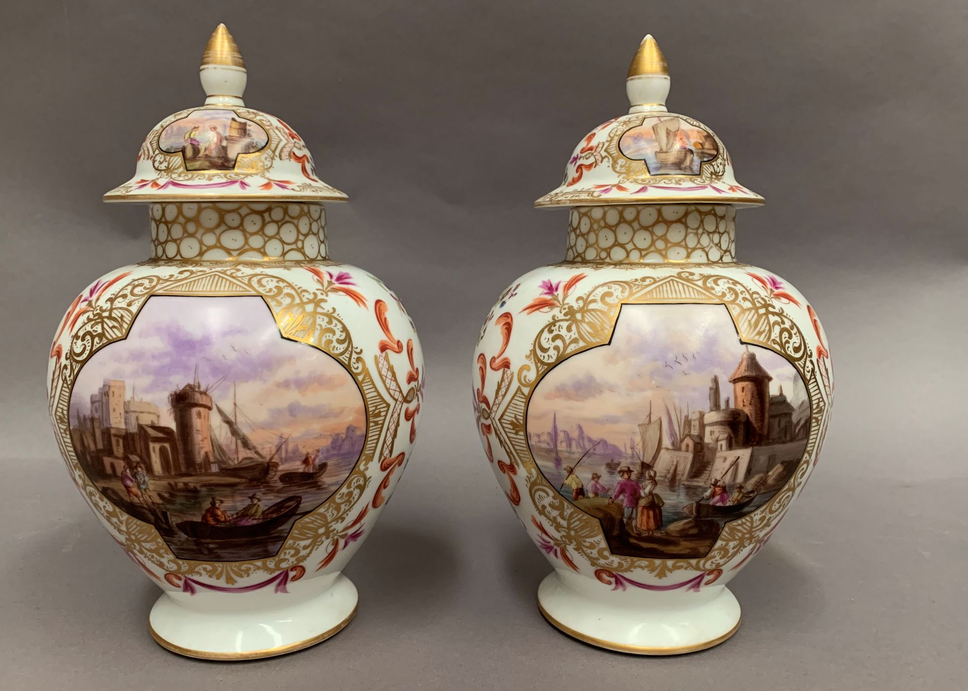 Lot 37 - A pair of vases and covers each with two panels to the vase and two to the cover depicting coastal