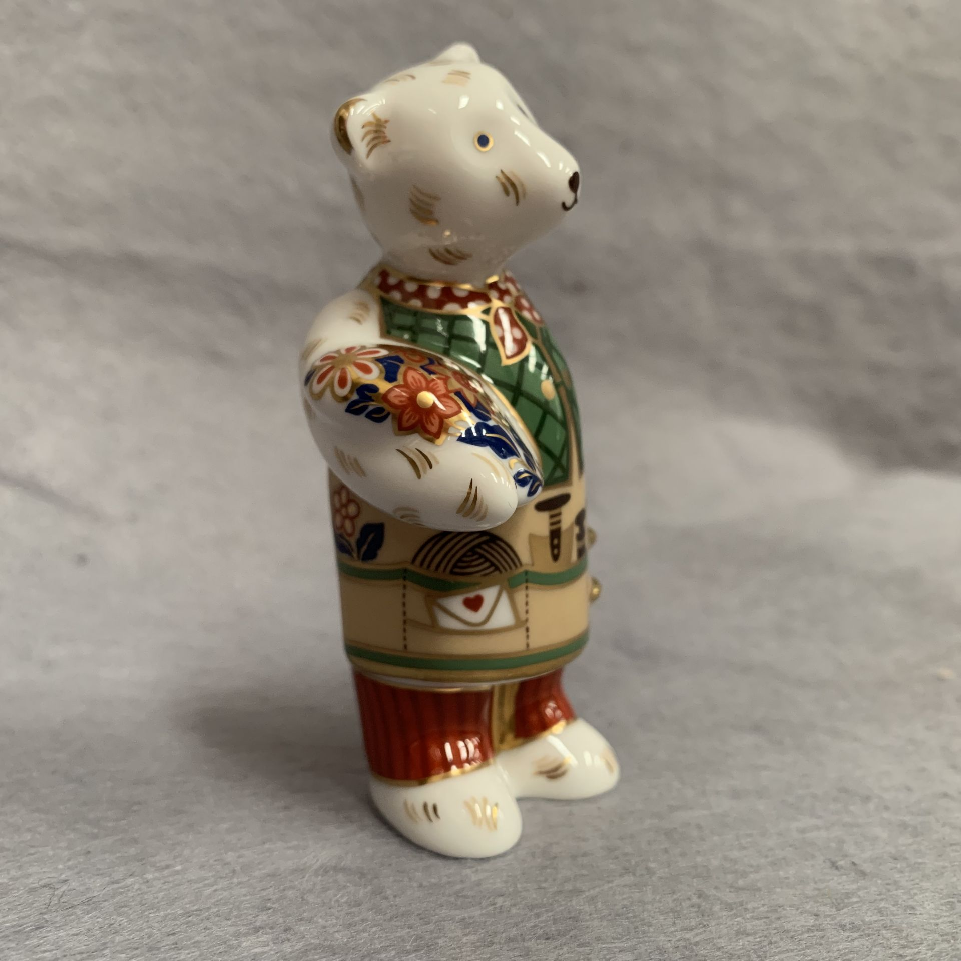 Lot 17 - Royal Crown Derby paperweight modelled as a Teddy carrying flowers,