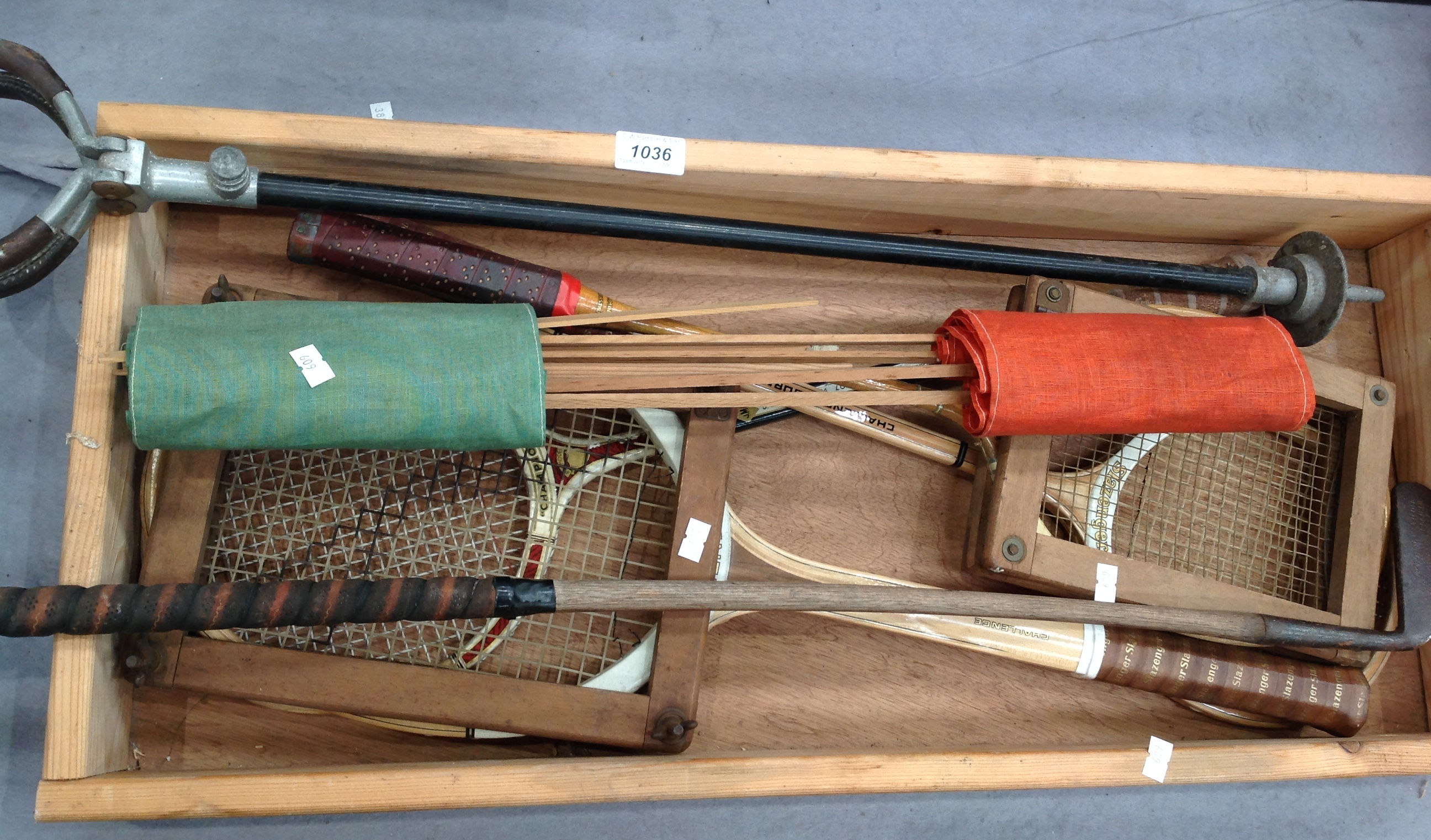 Lot 1036 - Contents to tray - Slazenger tennis racquet, kite, shooting stick, old golf club,
