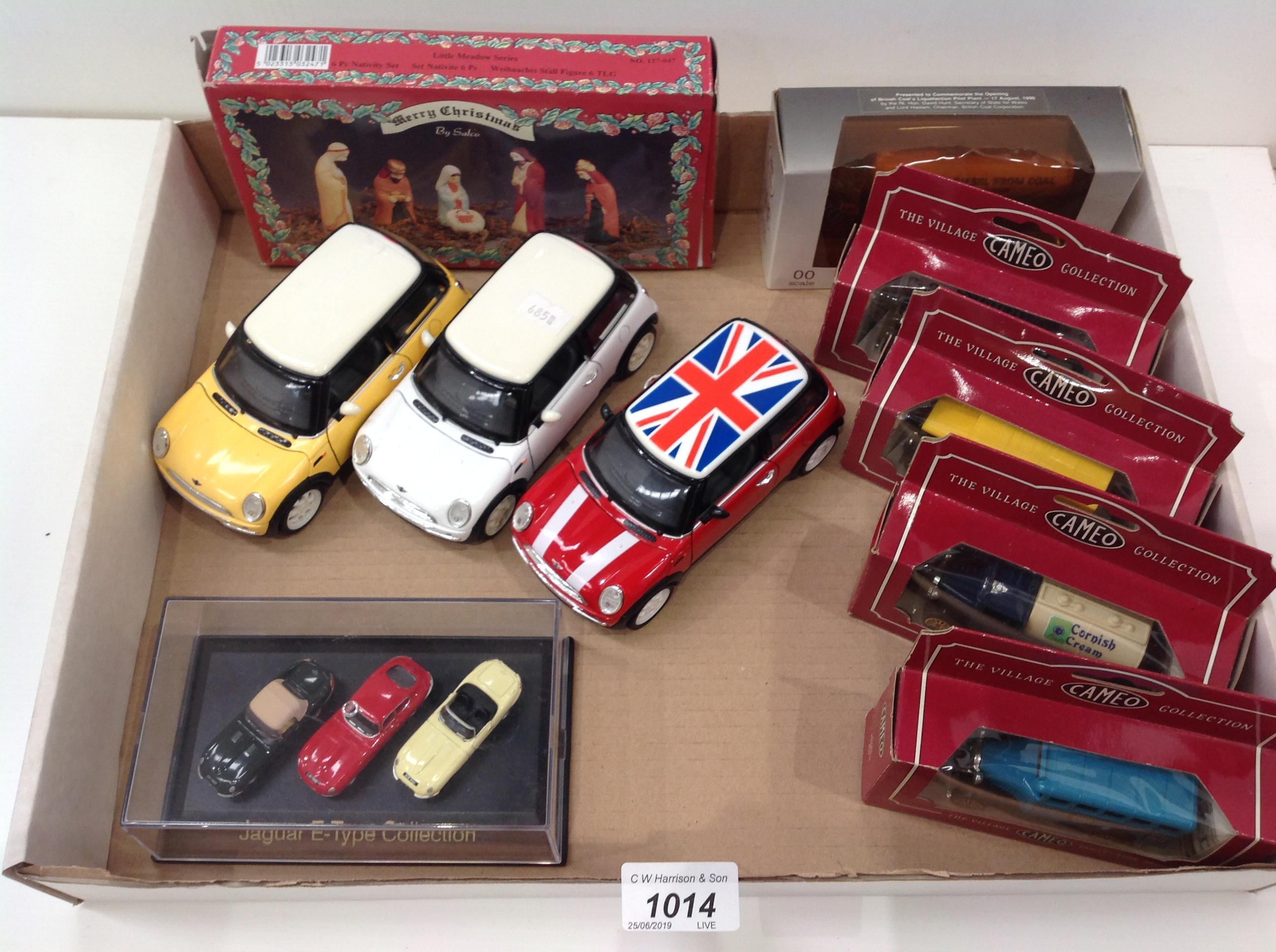 Lot 1014 - Three die cast 1:24 scale Mini Cooper cars (unboxed), a miniature Jaguar E-Type collection (boxed),