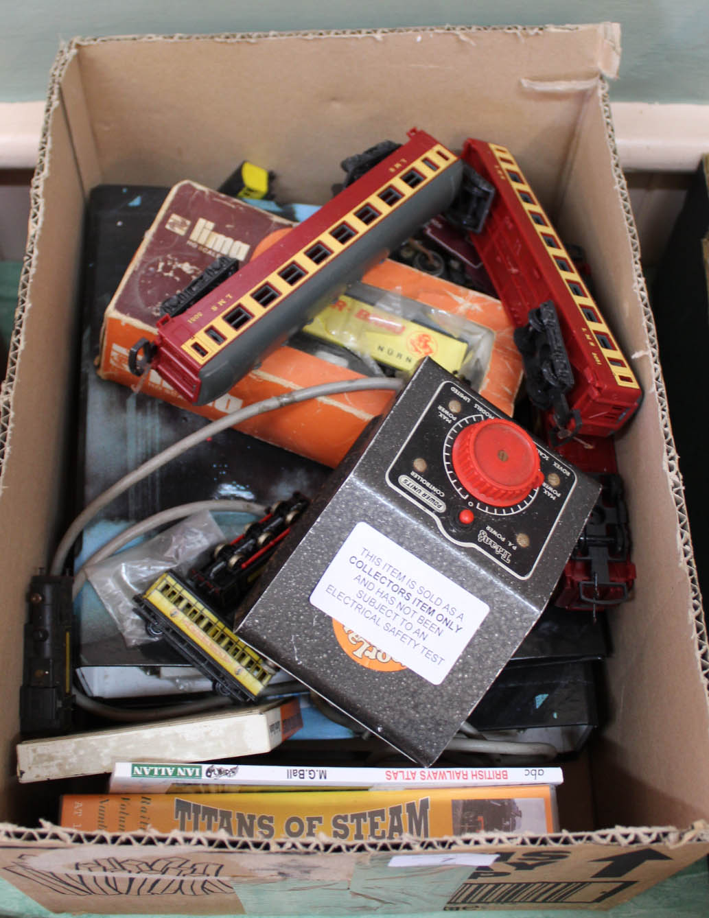 Lot 7 - Railway items to include Lima N gauge loco and carriages etc plus Charlie Chaplin Arrow film