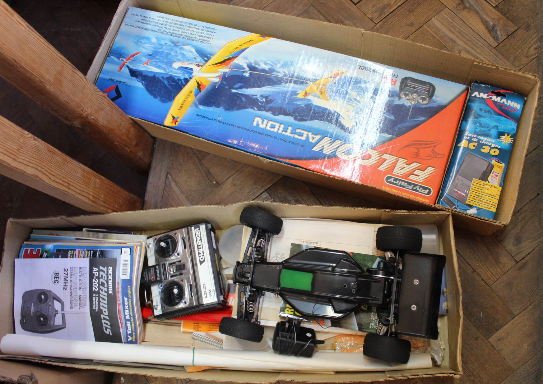 Lot 45 - A boxed radio controlled Falcon aircraft plus an unboxed race car and remote control accessories