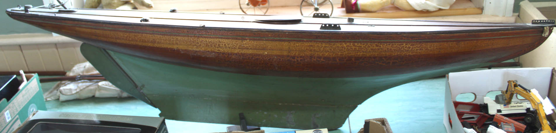 Lot 33 - A large model pond yacht and sails