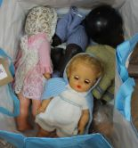 Lot 36 - A composition ethnic doll plus three others