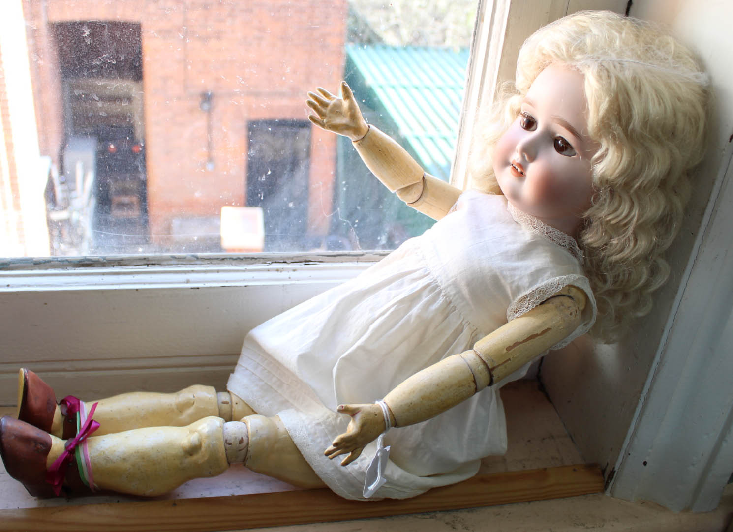 Lot 48 - A German bisque head doll marked Special on Victorian jointed wooden body,