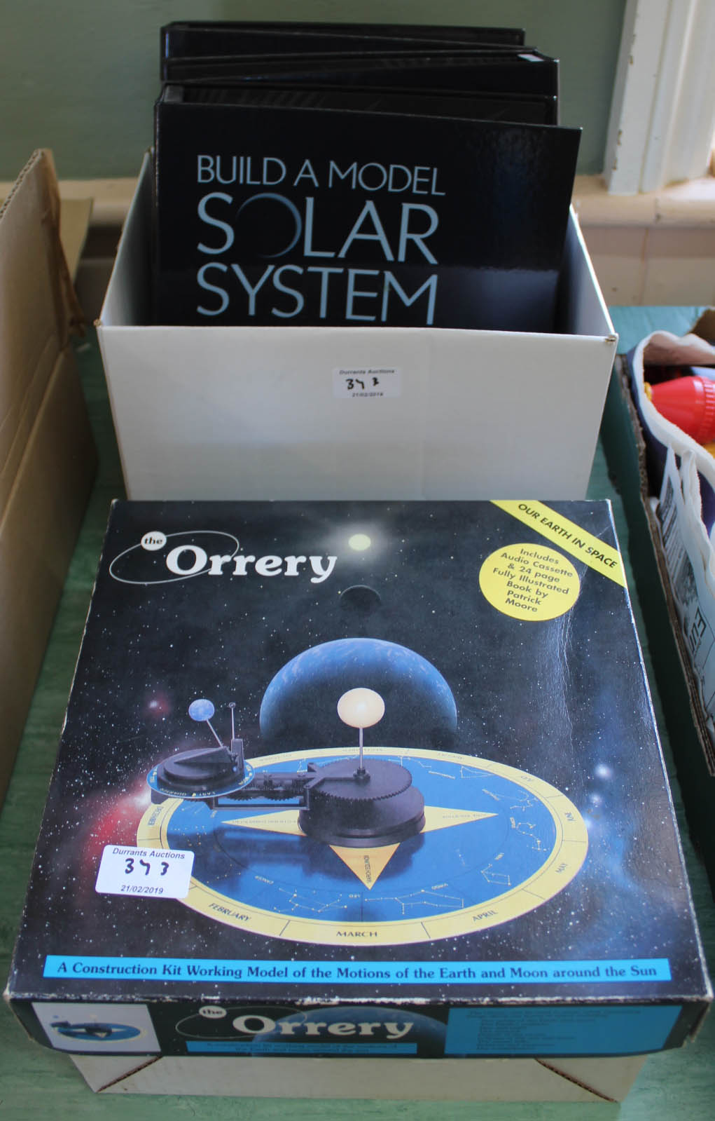 Lot 37 - A brass model orrery and magazines,