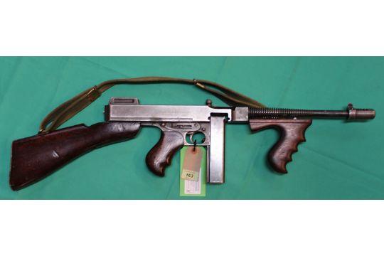 A  45 A C P  Thompson model 28AI sub-machine gun, with Cutts