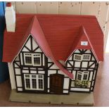 Lot 57 - A half timbered dolls house