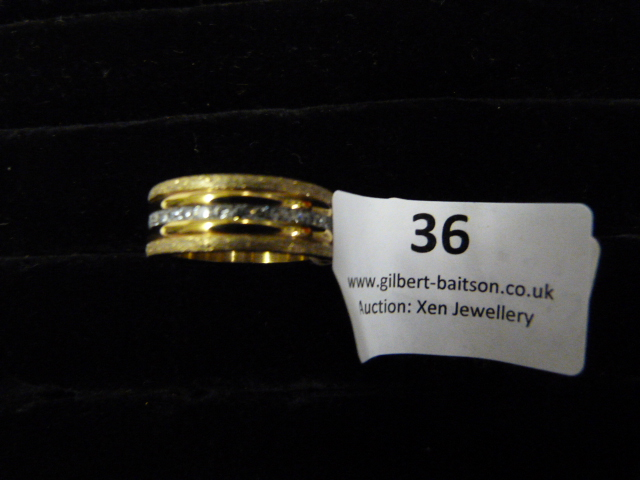 Lot 36 - *Edblad Gold Ring with CZ Stones