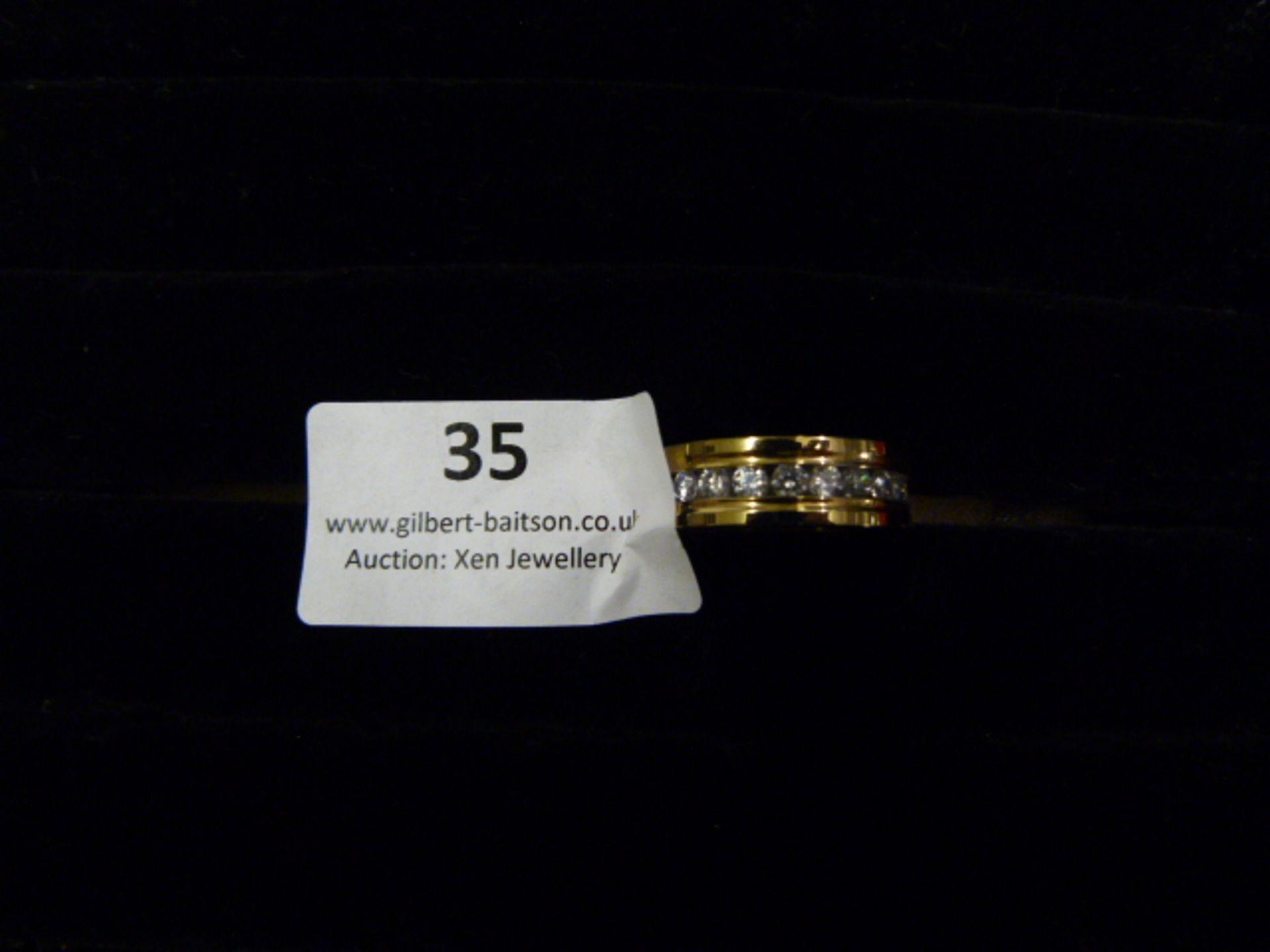 Lot 35 - *Edblad Gold Ring with CZ Stones