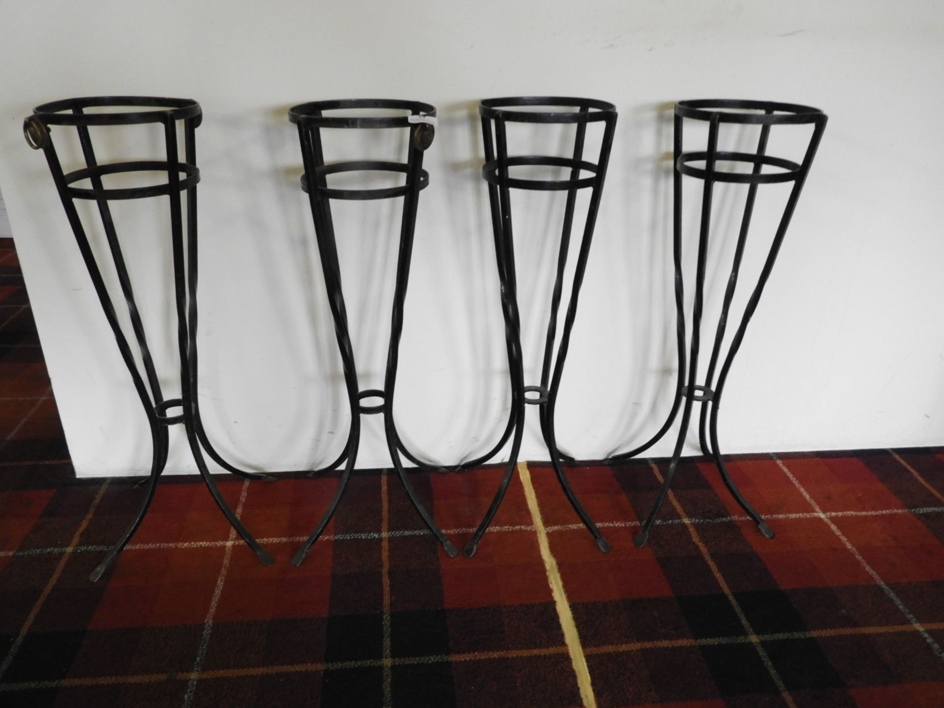Lot 24 - *Four Wrought Iron Wine Bucket Stands