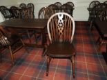 Lot 21 - *Twenty Two Wheelback Dining Chairs in Darkwood Fi
