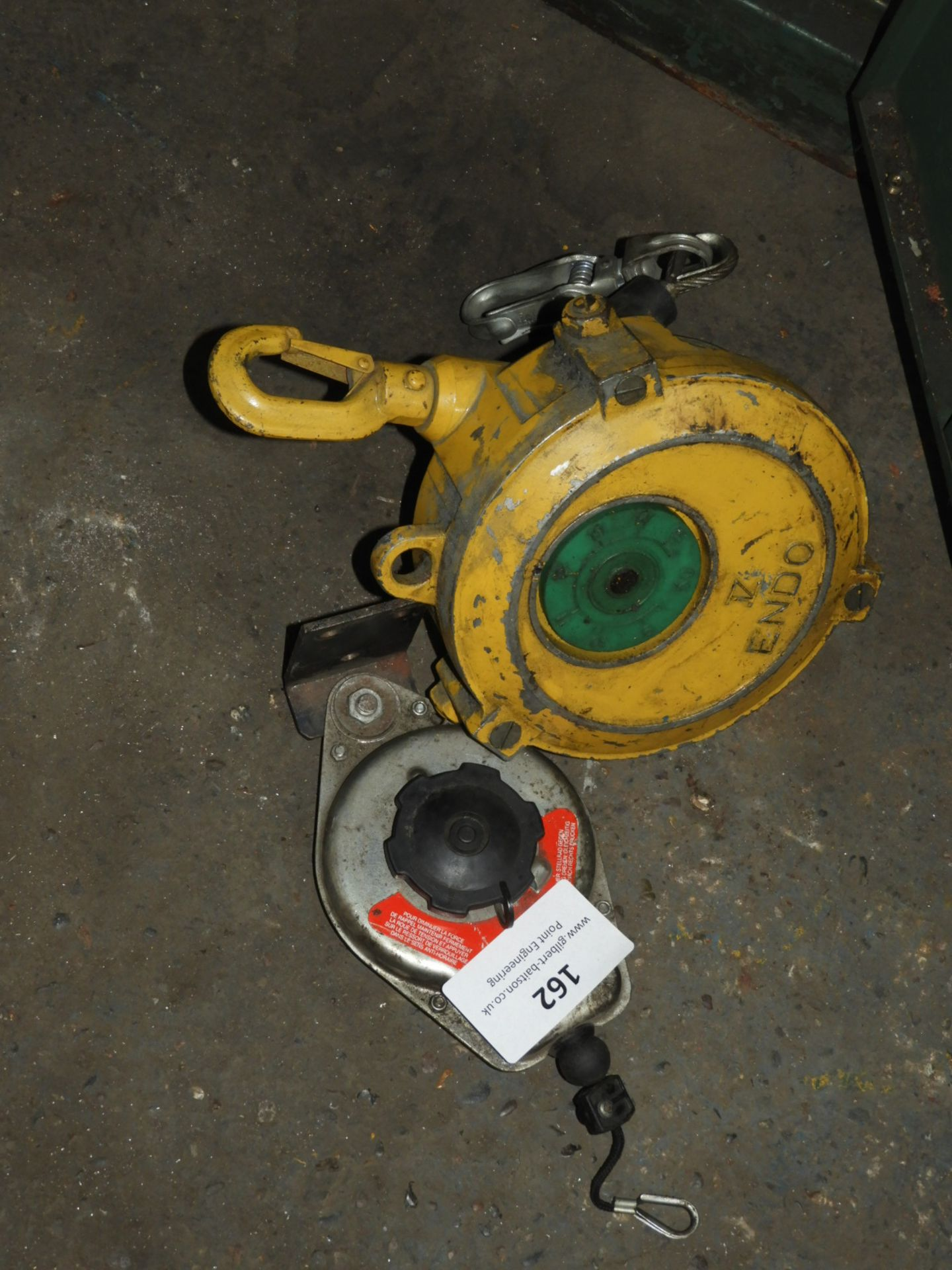 Lot 162 - *Two Spring Loaded Balancers