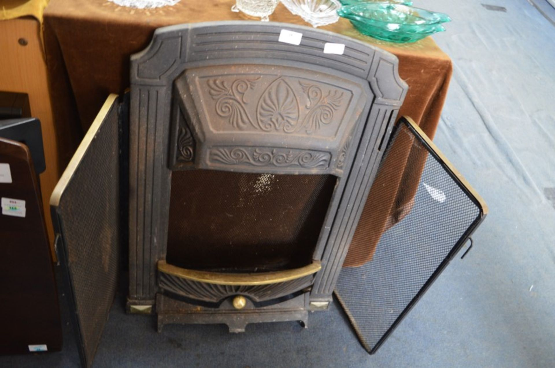 Cast Iron Fire Place and a Brass Fire Screen