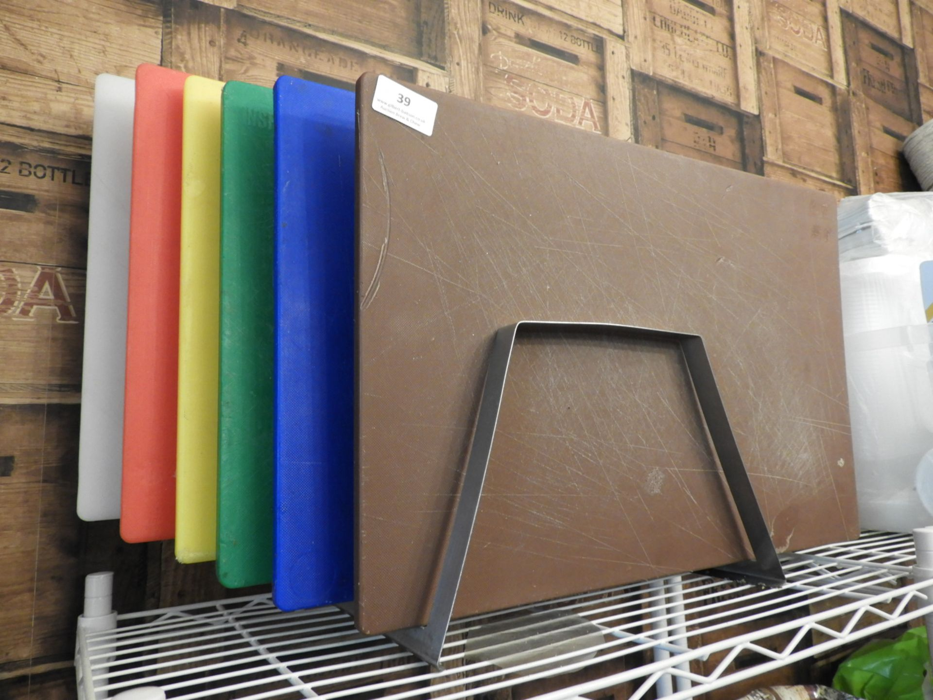 Lot 39 - Six Coloured Chopping Boards on Stainless Steel Ra