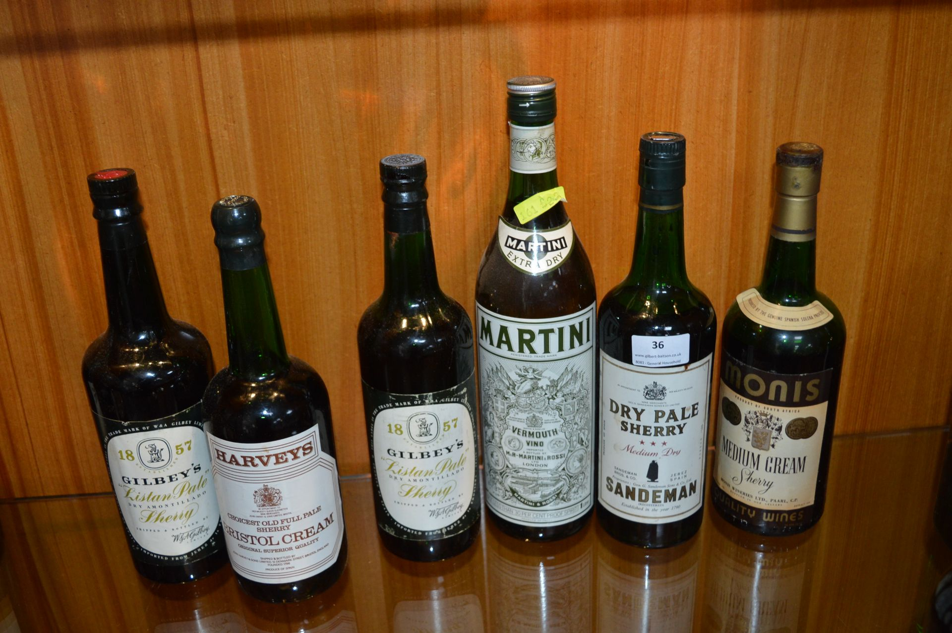 Lot 36 - Five Bottles of Sherry and a Bottle of Martini Ext