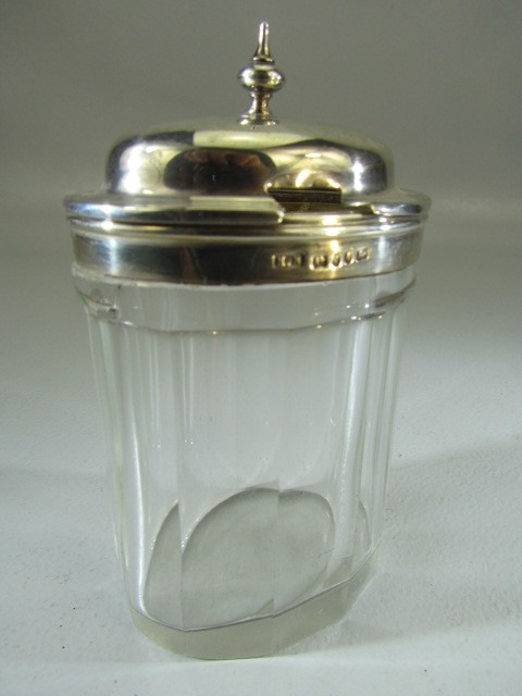 Lot 10 - Hallmarked silver trophy with two handles - 53.9g along with a silver topped relish jar Henry