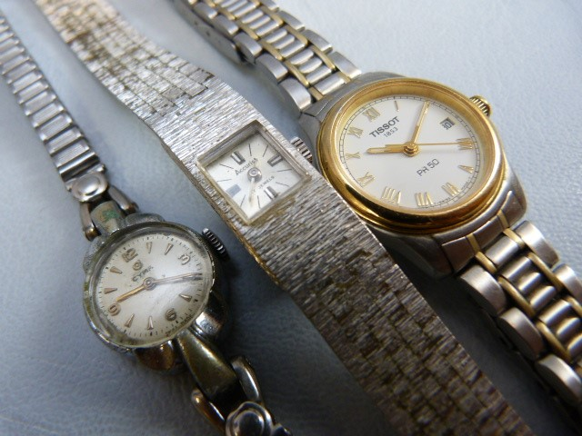 Lot 51 - Three ladies silver coloured metal wrist watches. Two dress watches A/F by Accurist & CYMA and a