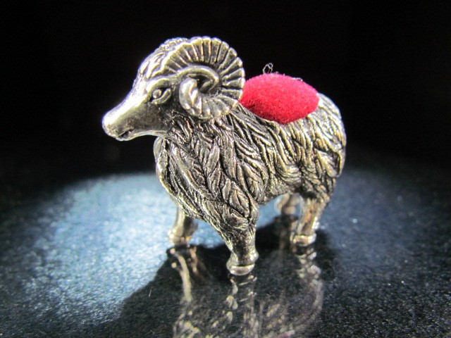Lot 13 - Sterling silver pin cushion in the form of a ram