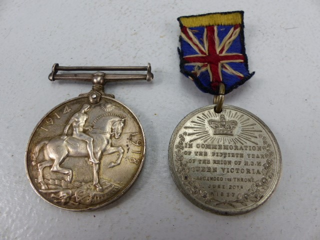 Lot 40 - The Great War Medal (missing ribbon) to 8645 PTE A J Fensome. also a commemorative medallion for