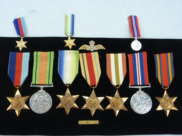 Lot 34 - MILITARY MEDALS: SEVEN WWII medals awarded to S.F.X 1221 H.G.HAMMACOTT L.A.M.E R.N.F.A.A. THE