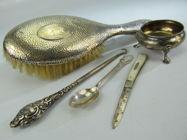 Lot 16 - Collection of hallmarked silver items to include a silver backed brush, silver handled button